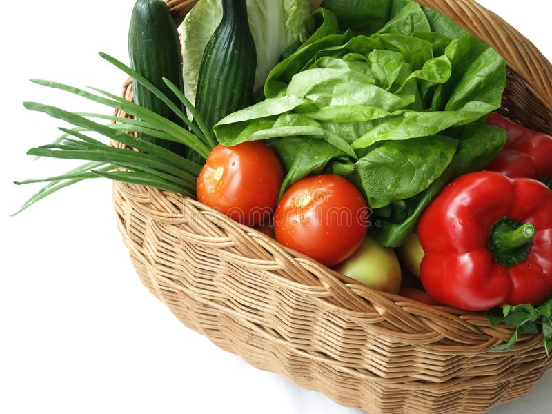 Basket with vegetables, isolated stock images