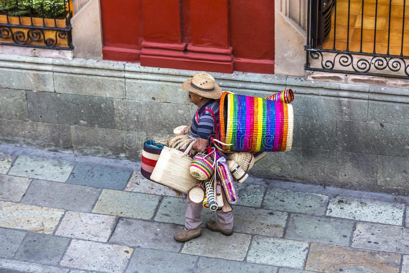 Basket Vendor in Mexico. A man selling woven baskets on the street in Oaxaca, Mexico stock images