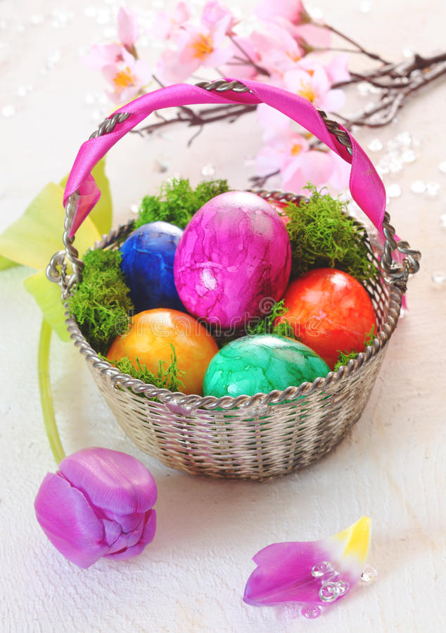 Basket Of Vibrant Marbled Easter Eggs stock image