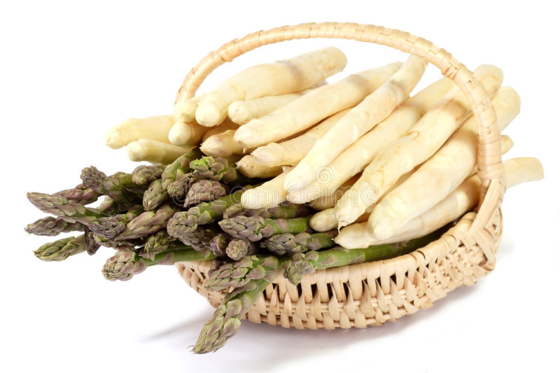 Basket of white and green asparagus royalty free stock image