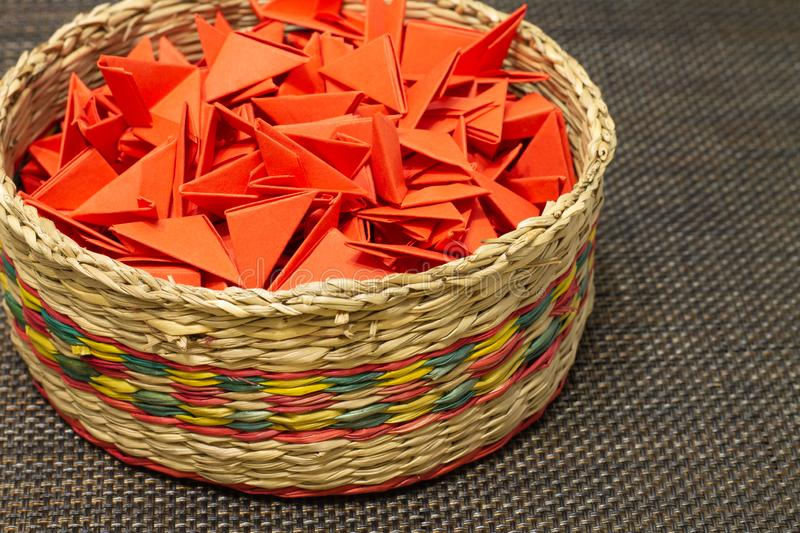 Basket of woven straw with red paper stock photography
