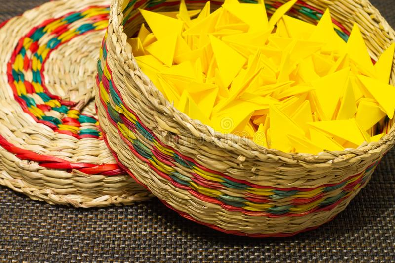 Basket of woven straw with yellow paper royalty free stock photo