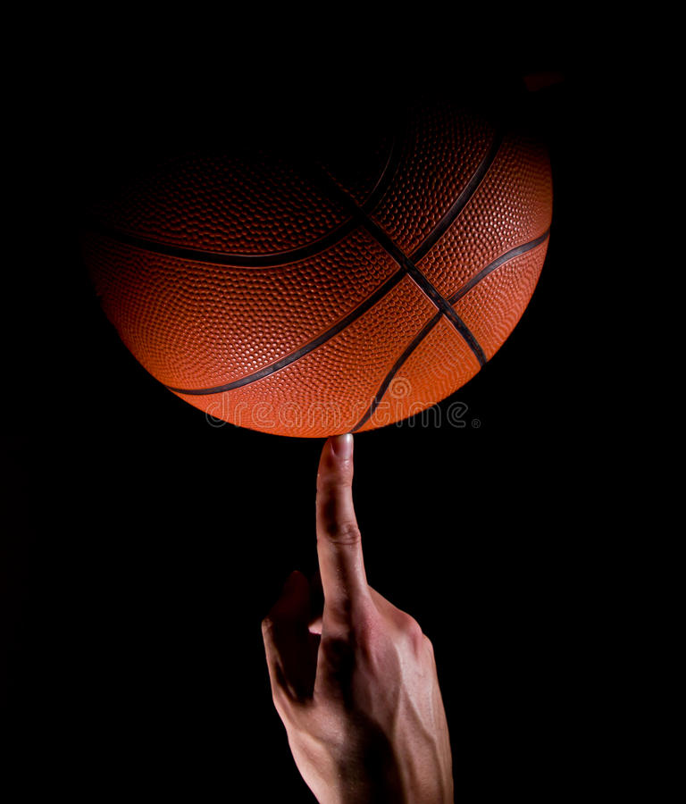 Basketball. Player Holds a Basketball with finger stock images