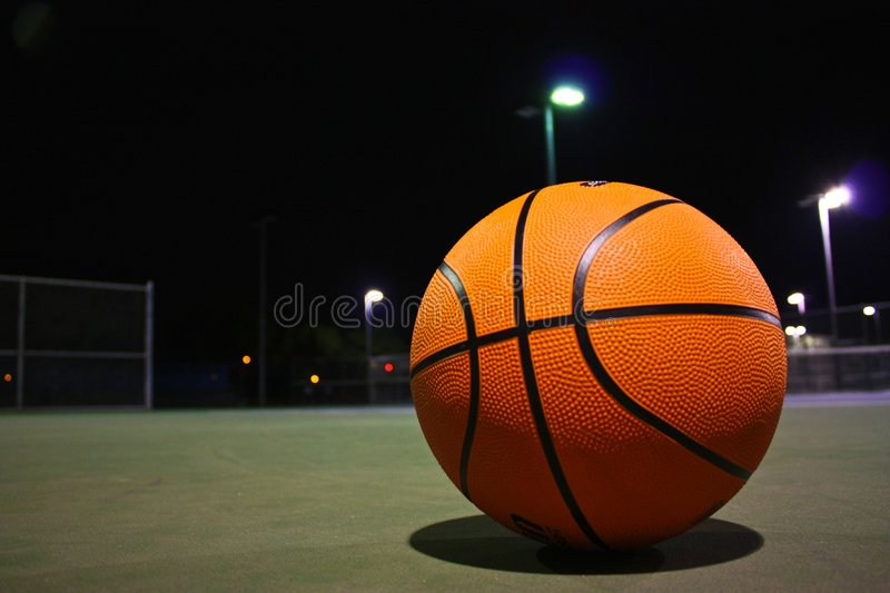Basketball. An isolated basketball at night stock images