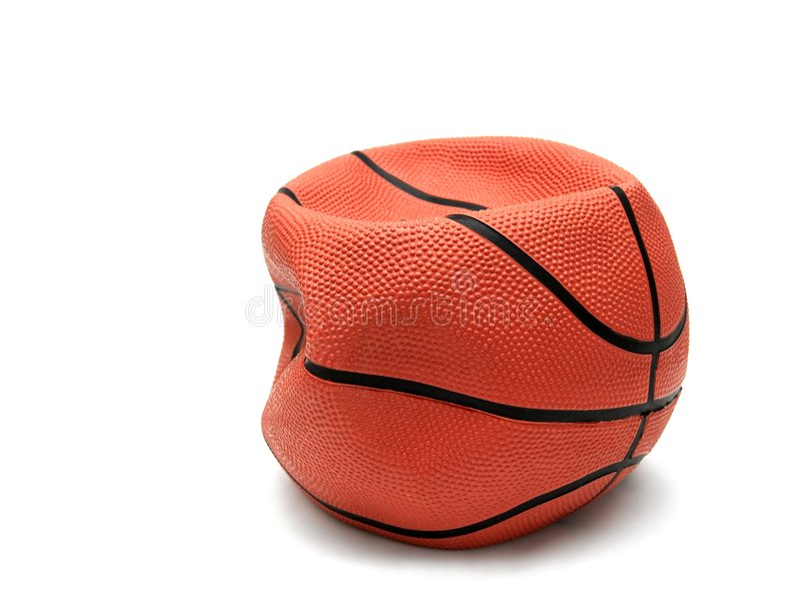 Basketball. Soft, broken basketball isolated on white stock photo