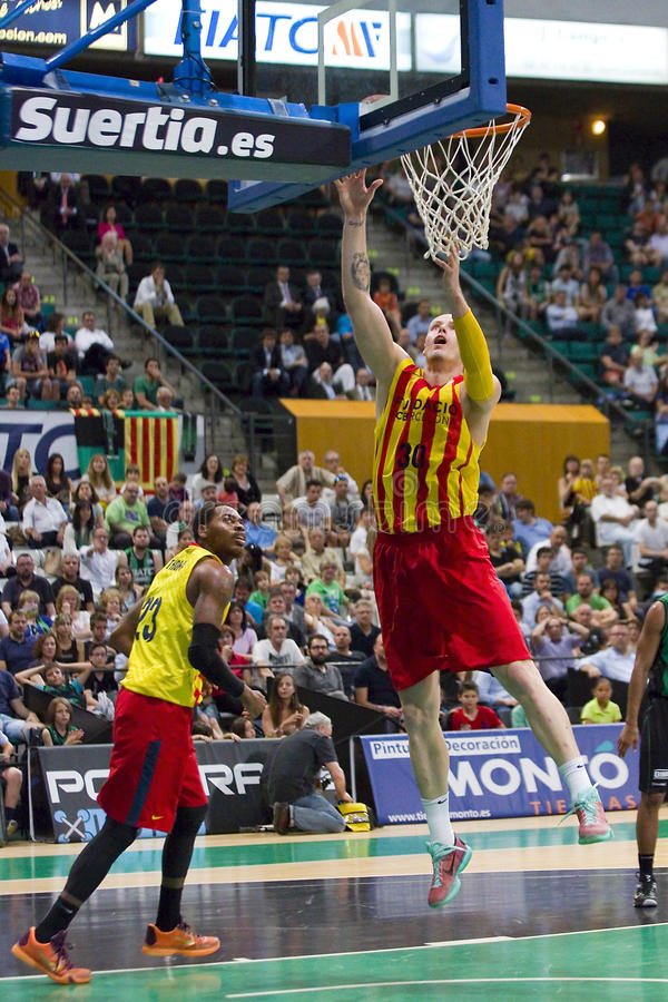 Basketball action. Maciej Lampe of FCB in action at Spanish ACB Basketball League match between Joventut Badalona and FC Barcelona, final score 74-80, on May 30 stock image