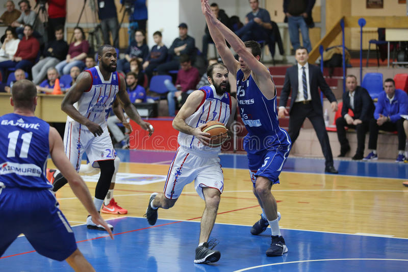 Basketball action. Pankracije Barac player of Steaua CSM Exim Bank Bucharest pictured in action during the game between his team and BC Mures Targu Mures stock images