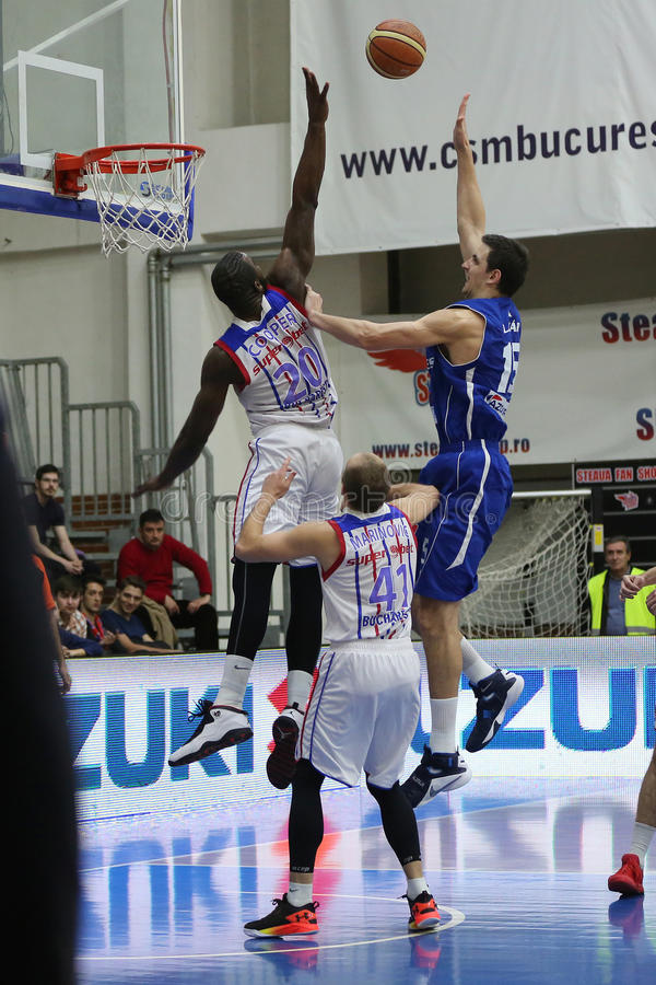 Basketball action. Basketball players, Lazar Laszlo and Christopher Cooper pictured in action during the game between Steaua CSM Exim Bank Bucharest and BC Mures royalty free stock photos