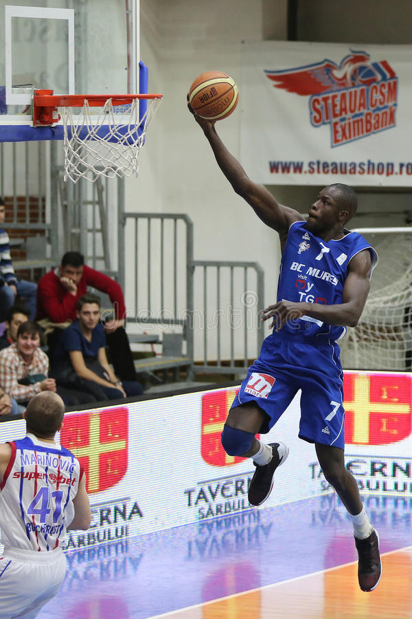 Basketball action - slam dunk. Barro Ousmane, player of BC Mures Targu Mures pictured in action during the game between his team and Steaua CSM Exim Bank stock image
