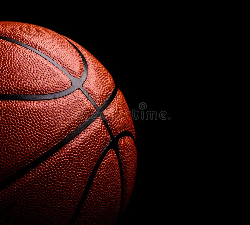 Basketball ball on black background. Activity, athletic, circle, closeup, competition, competitive, design, equipment, fitness, fun, game, health, isolated stock image
