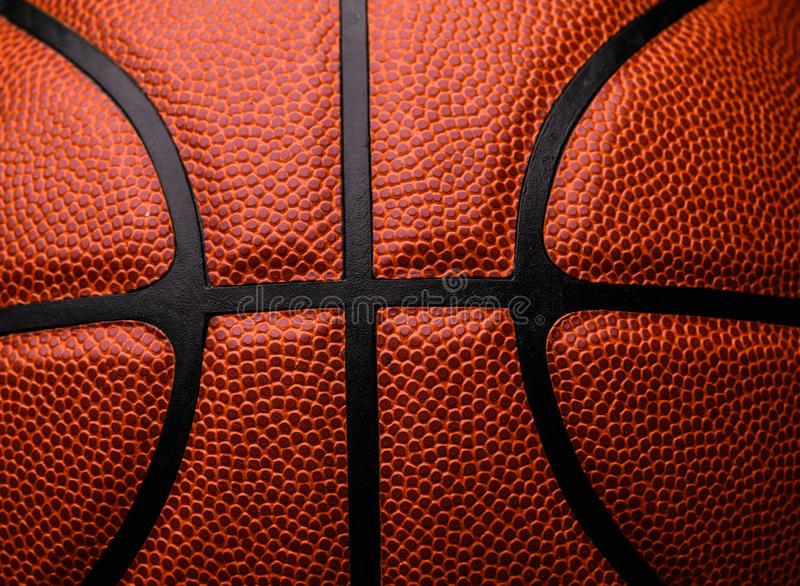 Basketball ball on black background. Activity, athletic, circle, closeup, competition, competitive, design, equipment, fitness, fun, game, health, isolated stock images
