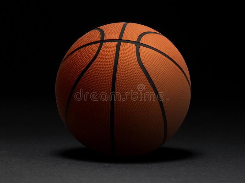 Basketball ball on black background. In the dark room.for design In the media stock photos