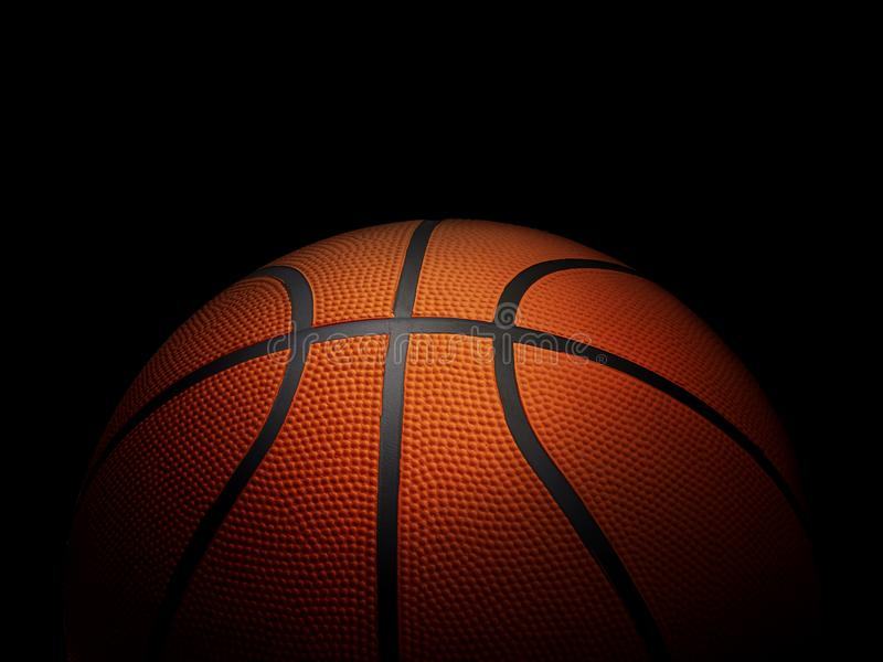 Basketball ball on black background.In the dark room. For design In the media Advertising royalty free stock photo