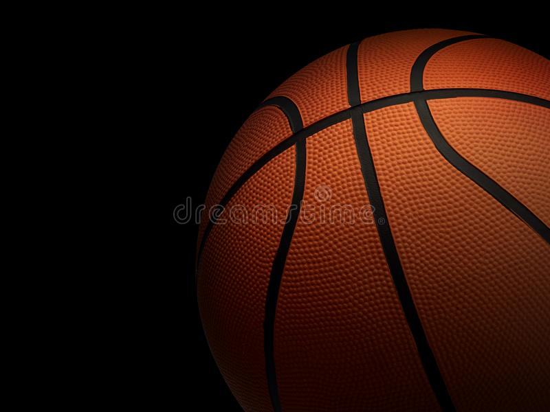 Basketball ball on black background. In the dark room. For design In the media royalty free stock images