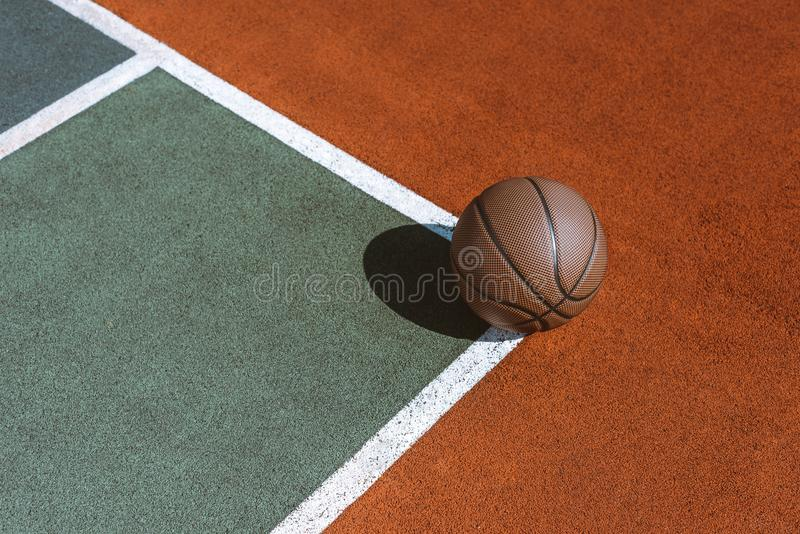 Basketball ball on the ground. At sports field royalty free stock photography