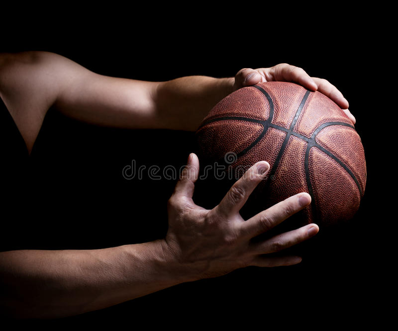 Basketball ball in the hands royalty free stock image