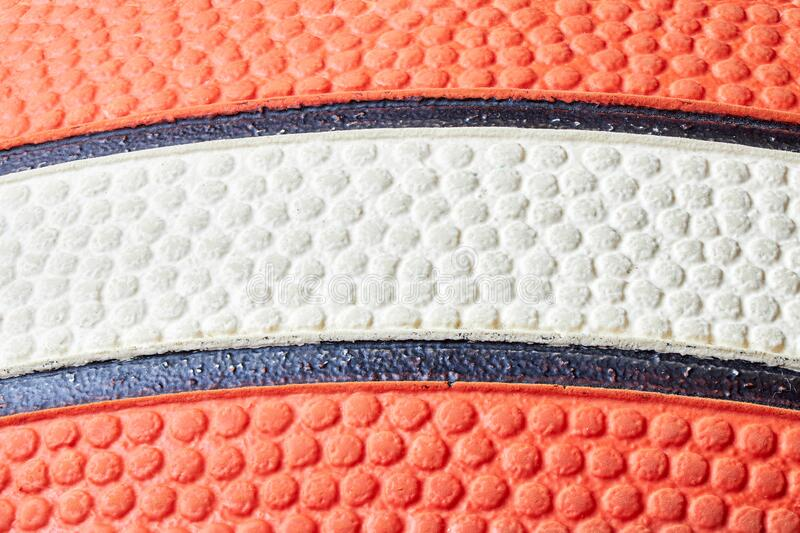 Basketball ball orange and white with black stripes skin closeup macro texture stacked photo for design background with copy space royalty free stock photo