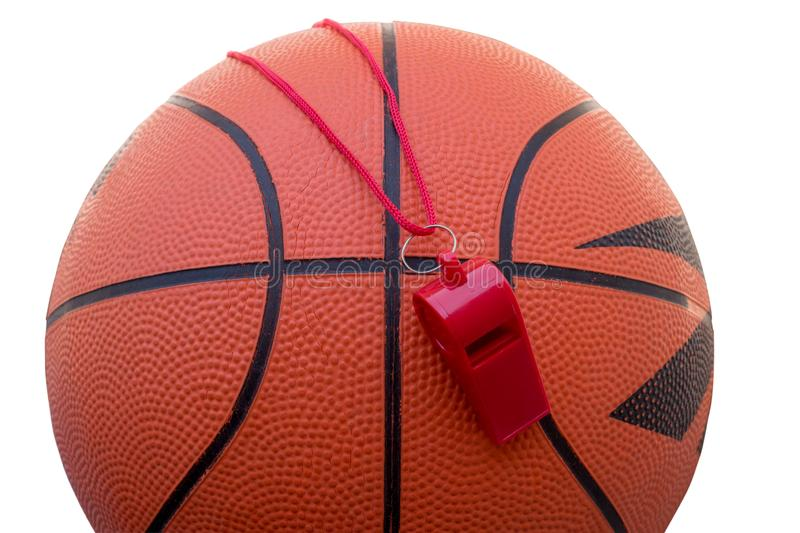 Basketball  ball and sports whistle isolated on white. Concept - sports competitions, game, training, match royalty free stock images