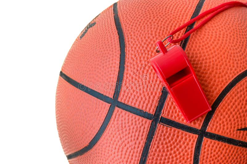 Basketball  ball and sports whistle isolated on white. Concept - sports competitions, game, training, match stock photo