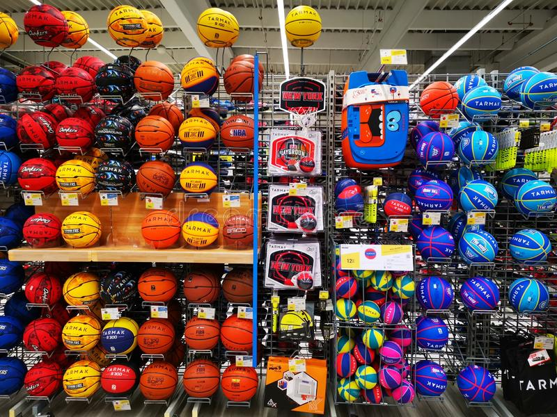 Basketball balls of different colors at Decathlon. Bucharest, Romania. Decathlon is a manufacturer and distributor of sporting goods, sports equipment and stock photography