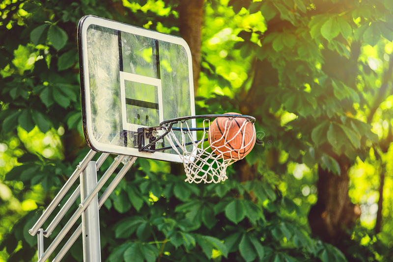 Basketball basket with all going through net stock images