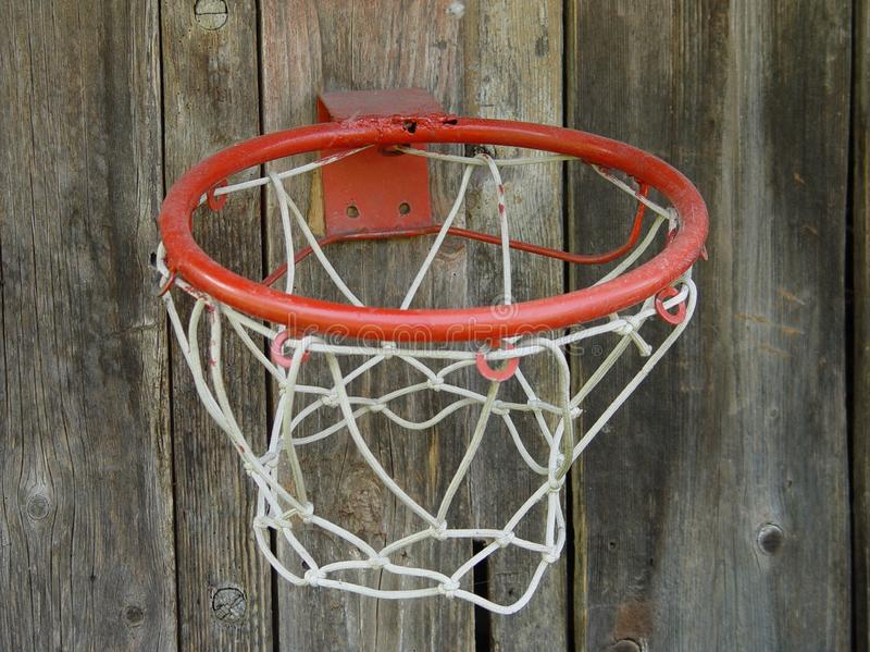 Basketball basket attached to a wooden fence boards stock photos