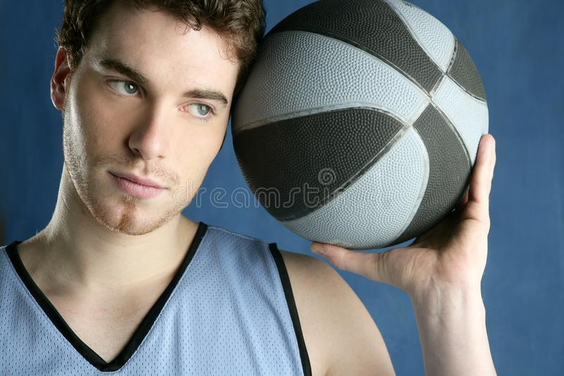 Basketball basket ball real player portrait. Over grunge blue royalty free stock image