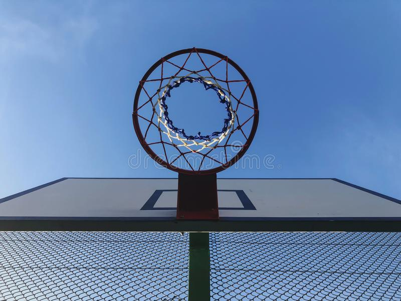 Basketball basket and board on the blue sky background royalty free stock images