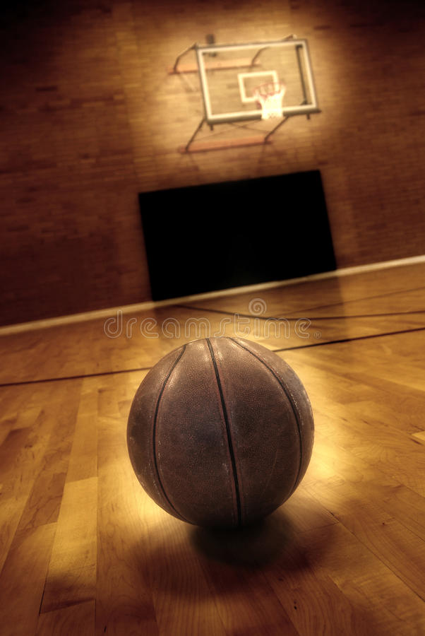 Basketball and Basketball Court. Basketball on floor of empty basketball court royalty free stock photography