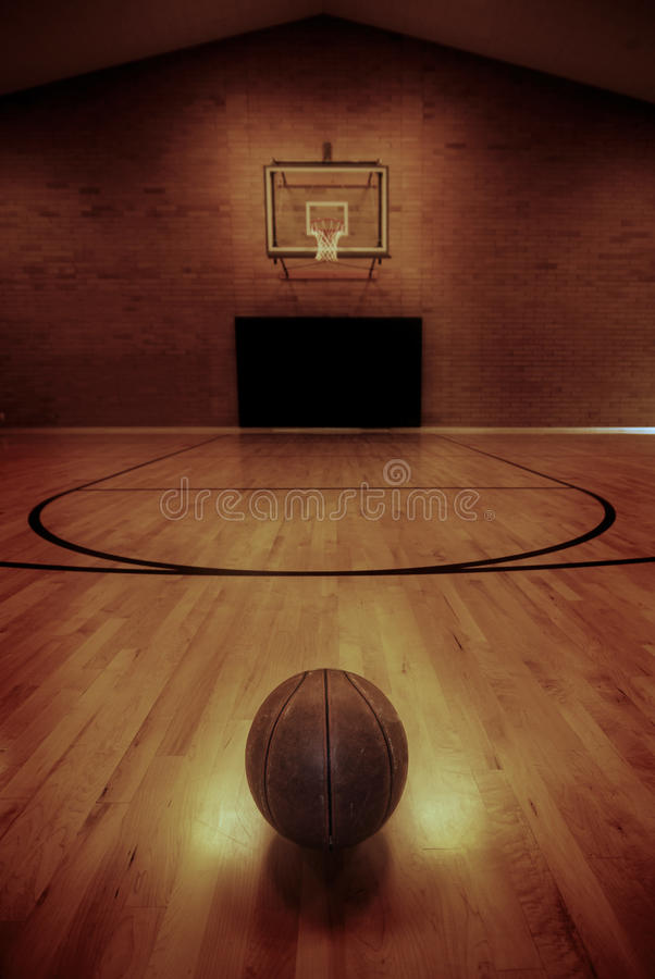Basketball and Basketball Court. Basketball on floor of empty basketball court royalty free stock image
