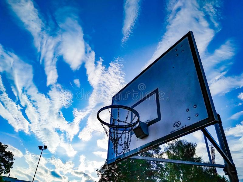 Basketball board and sky royalty free stock image