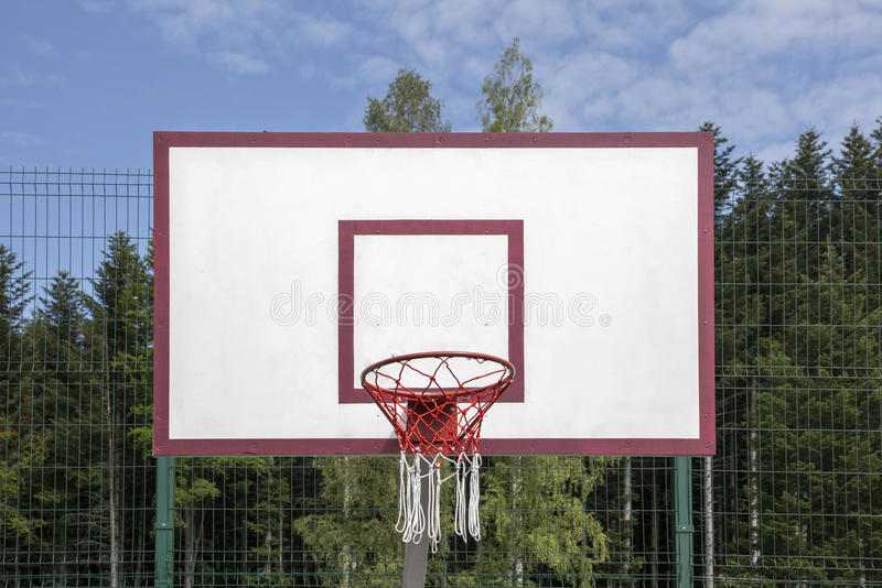 Basketball board on the sports field stock image