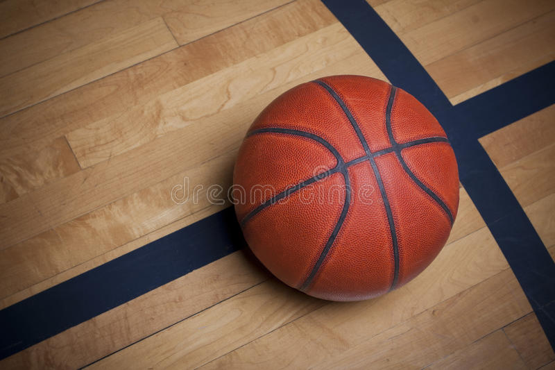 Basketball on the court. A directly above view of a ball on a basketball court floor royalty free stock photo