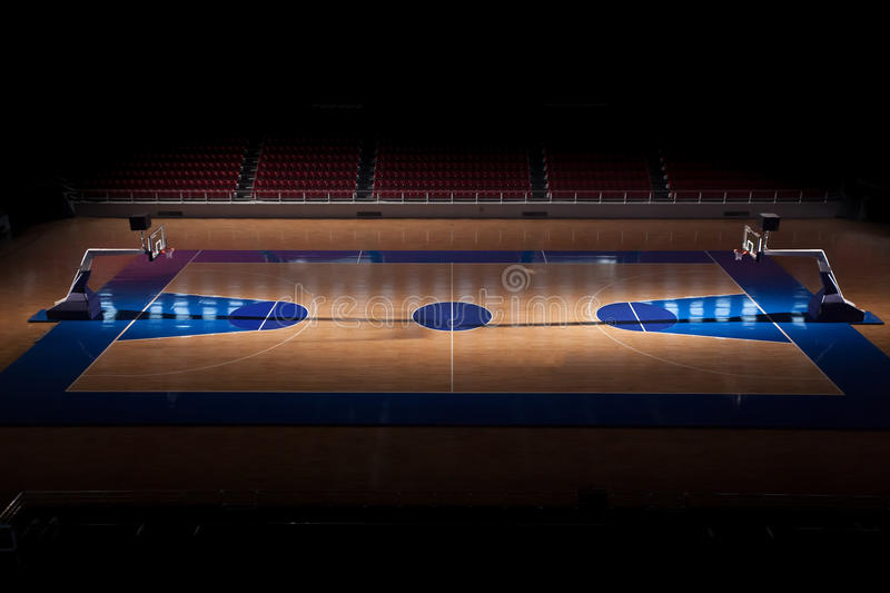 Basketball Court. Empty basketball court with dramatic lighting royalty free stock image