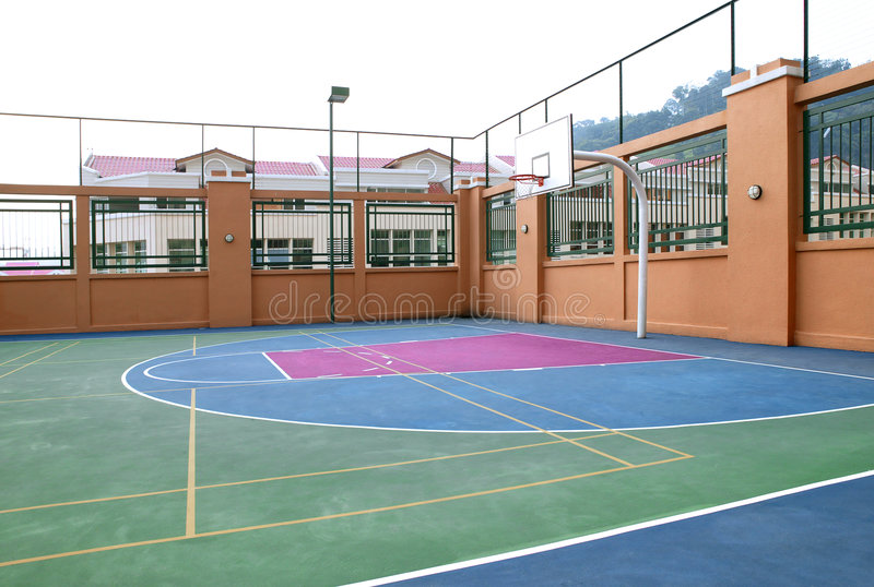 Basketball court. Empty basketball court in public playground royalty free stock photo