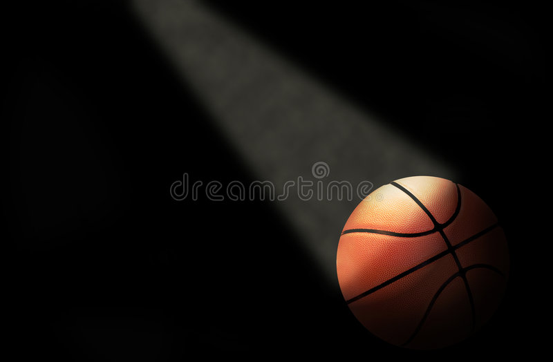Basketball on the court. A dramatically lit basketball on the court royalty free stock photo