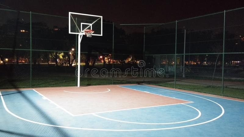 Basketball court stock photo image of hoop night for Custom basketball court cost