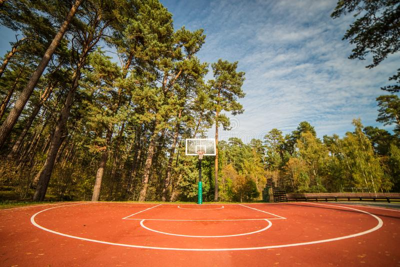 Basketball court. In a forest, blue sky and fresh air royalty free stock photography