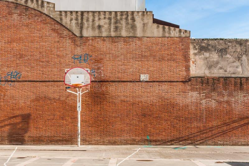 Basketball court with old ring. Outdoor in Sant Feliu de Llobregat, Barcelona, Spain stock photos