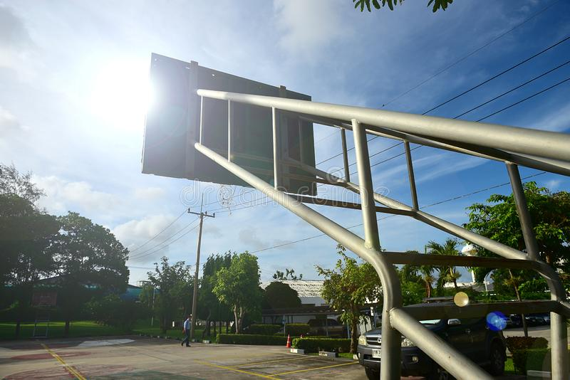 Basketball court  with old wood backboard.blue sky and white clouds on background. Old Basin Stadium,on white background,with stock photo