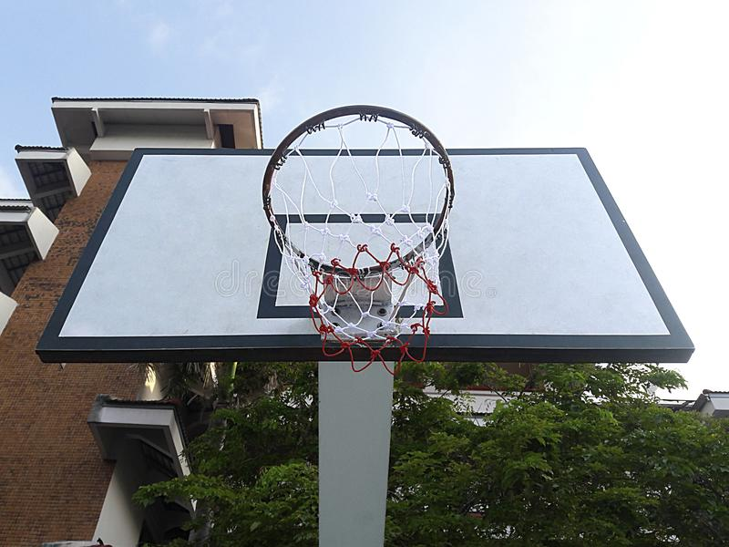 Basketball court with an orange ball in the outdoors. For design In the media royalty free stock photos