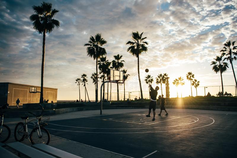 Basketball court at sunset stock image