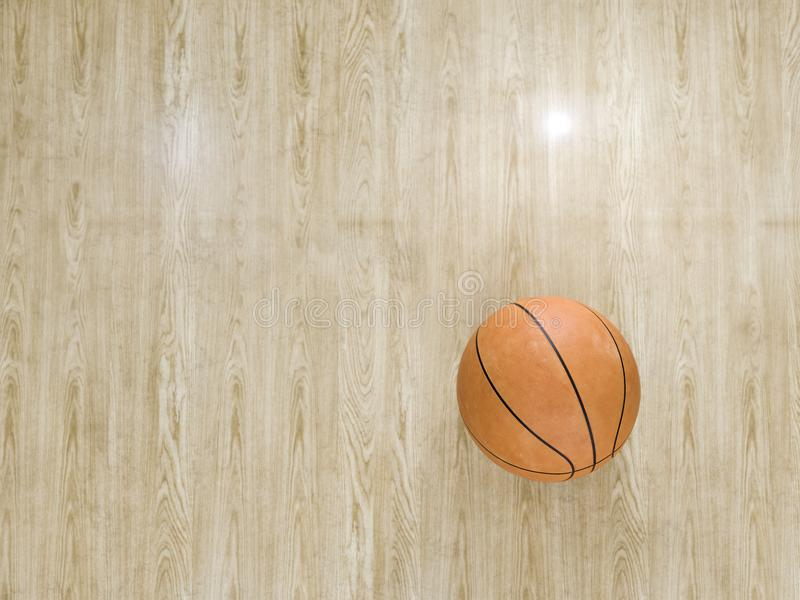 Basketball court wooden floor with ball on black with c royalty free stock photo