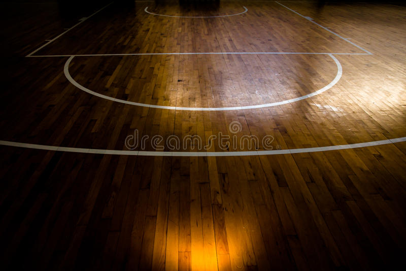 Basketball court. Wooden floor basketball court with light effect stock photography