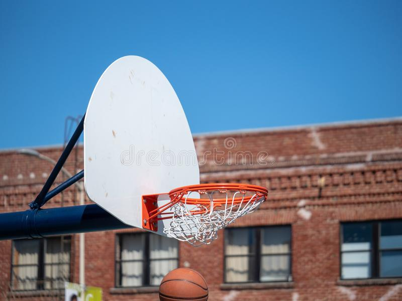 Basketball falling through the hoop immediately after making a s royalty free stock image
