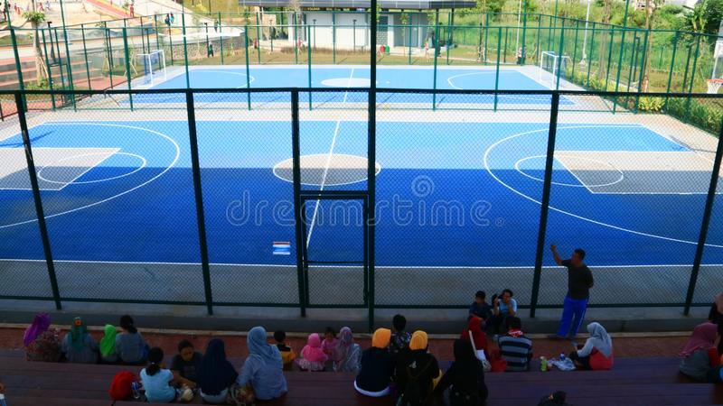 Basketball and futsal field. Depok, Indonesia - April 14, 2019: Basketball and futsal field at Alun-Alun Depok green open space in Grand Depok City, West Java stock photo