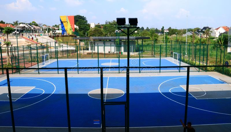 Basketball and futsal field. Depok, Indonesia - April 14, 2019: Basketball and futsal field at Alun-Alun Depok green open space in Grand Depok City, West Java royalty free stock photos