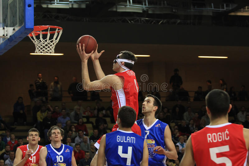 Basketball game. RIJEKA, CROATIA - FEBRUARY 21: basketball game between North and South (Croatian All Star game) 2015. in Rijeka, Croatia. Lovro Mazalin royalty free stock images