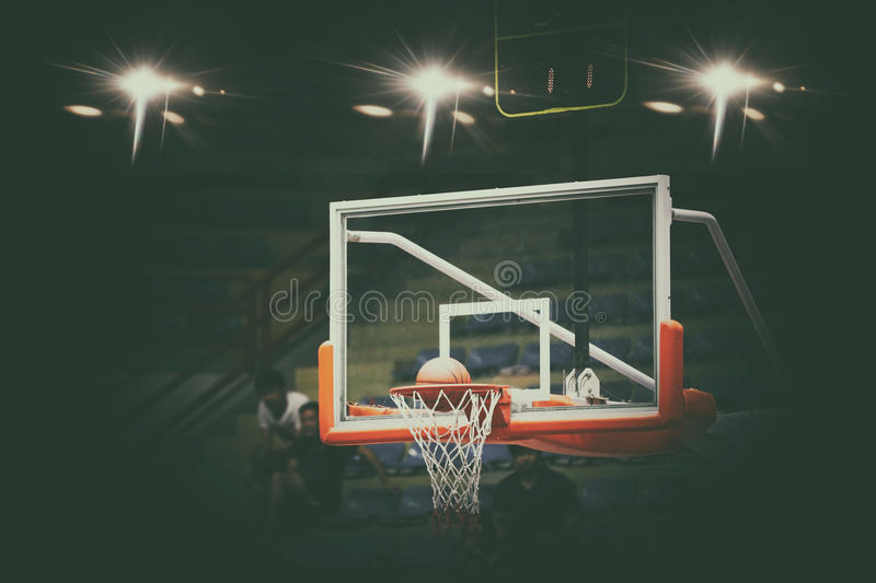 Basketball going through net and scoring during match ,Blurry an stock photography