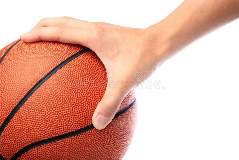 Basketball and hand royalty free stock photo